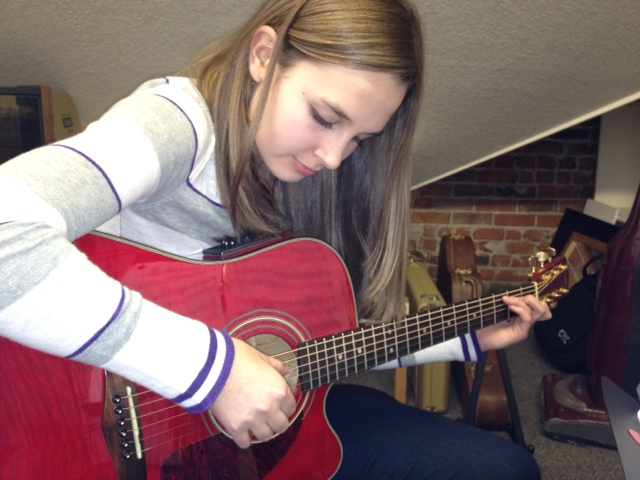 R and her red guitar went off to college.  :(
